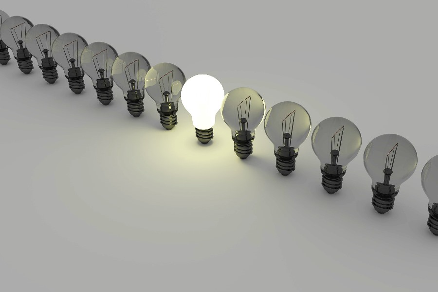 string of light bulbs with one lit